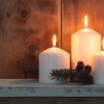46562441 - christmas candles and fir branches over wooden background
